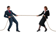 stock-photo-43961564-businessman-and-woman-tug-of-war-isolated-on-white